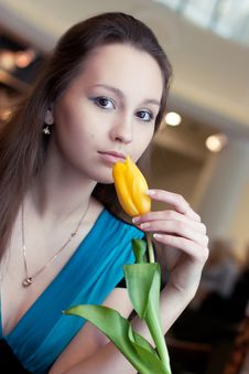 Girl With Yellow Tulip Royalty Free Stock Photos