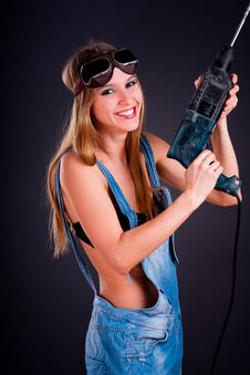 Girl With A Drill Stock Photography