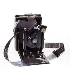 Old Camera With Negatives Stock Photo