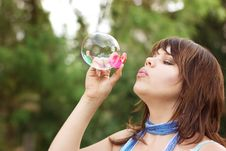 Free Attractive Girl Inflating Soap Bubbles Stock Photos - 18382483