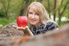 Free Beautiful Smiling Young Woman With Red Apple Royalty Free Stock Photo - 18382485