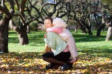 Free Beautiful Woman With Her Child On Back Royalty Free Stock Photos - 18382488