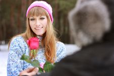 Free Man Handing Over A Single Red Rose To Young Woman Royalty Free Stock Photos - 18382508