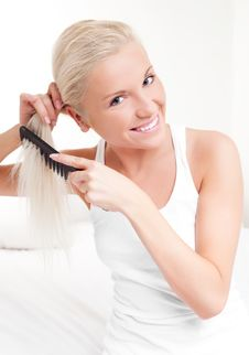 Free Woman Brushing Hair Stock Photography - 18383422