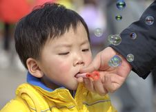 Free Baby Blowing Soap Bubbles Stock Photo - 18388150