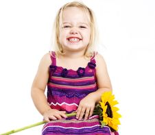 Free Young Girl Smiling With Sunflower Stock Photography - 18388892