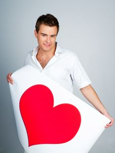 Free Man Holding A Red Heart Royalty Free Stock Image - 18389576