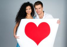 Free Couple Holding A Red Heart Royalty Free Stock Photography - 18389587