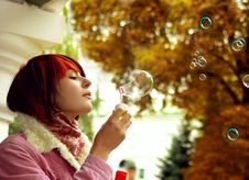 Free A Girl Is In An Autumn Park Royalty Free Stock Images - 18390229