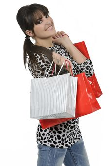 Free Young Woman Holding Shopping Bags Royalty Free Stock Image - 18390976