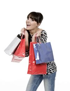 Free Young Woman With Full Of Bags Royalty Free Stock Photos - 18390978