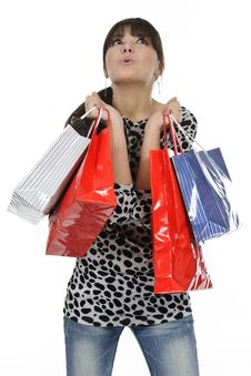 Young Woman With Full Of Bags Royalty Free Stock Images