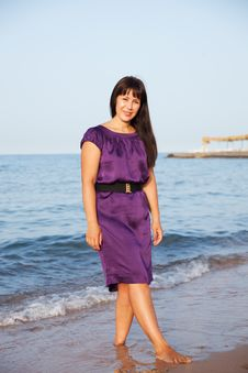 Woman In Dress Standing On Sand Royalty Free Stock Image