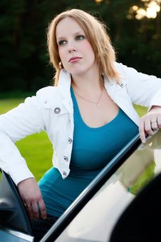 Posing With A Car Royalty Free Stock Photo