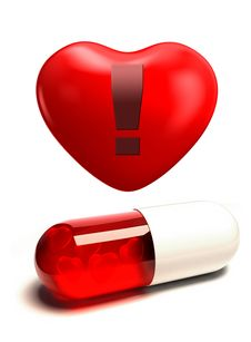 Capsule Pill And Heart Royalty Free Stock Photos