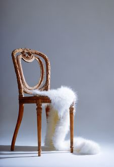 Old-fashioned Wooden Chair With White Fur Royalty Free Stock Photos