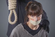 Woman And Hangman With Noose Stock Images