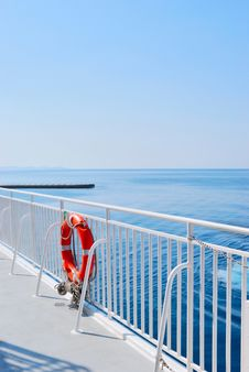 Free Red Lifebuoy In Front Of The Blue Sea Stock Image - 18398051