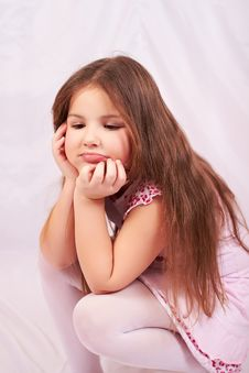 Free A Girl Sits Distraught. Royalty Free Stock Photo - 18398705