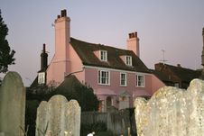 English Cottage And Graveyard Royalty Free Stock Photo