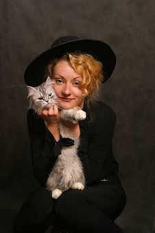 Portrait With A Cat Stock Images