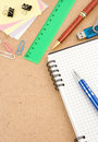 Free Office Accessories At Checked Notebook On Wood Stock Photography - 18406852