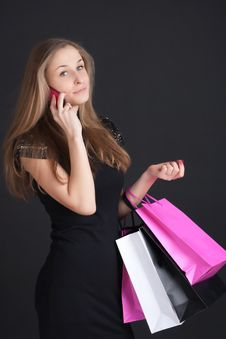 Girl With Shopping On The Phone Stock Photography