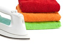 Free Iron And Stacked Colorful Towels. Stock Photography - 18404632