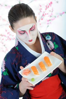 Beautiful Japan Geisha Woman With Sushi Stock Image