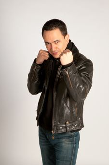 Tough Man In Leather Jacket In Fighting Pose