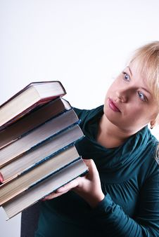 Free Girl Holds The Pile Of Books Stock Photos - 18407203