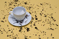 Free Tea Cup With Tea Leaves On A Yellow Table Stock Photography - 18414912