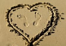 Free Foot Prints Inside A Sandy Heart Stock Photography - 18416692