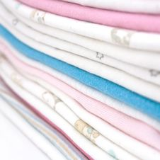 Free Pile Of Baby Clothes Royalty Free Stock Photos - 18419758