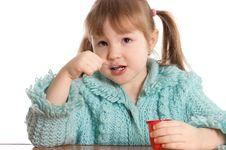 Free The Little Girl Eats Yoghurt Stock Photo - 18421790