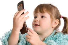 Free The Little Girl Speaks By Phone Royalty Free Stock Photography - 18421797