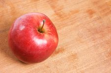 Red Apple On A Wooden Table Stock Photos