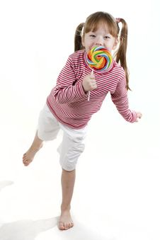 Little Girl Eatis A Lollipop Isolated On White Stock Photos