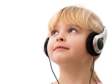 Little Girl In Headphones Royalty Free Stock Images