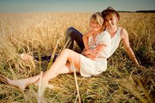 Free Image Of Young Man And Woman On Wheat Field Royalty Free Stock Image - 18428136