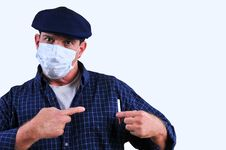 Free Man In Mask Pointing At Cigarette Stock Photography - 18429482
