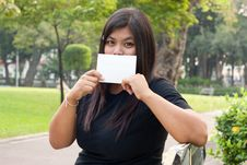 Free Women Sitting In The Park And Hold A White Card. Stock Photography - 18429602