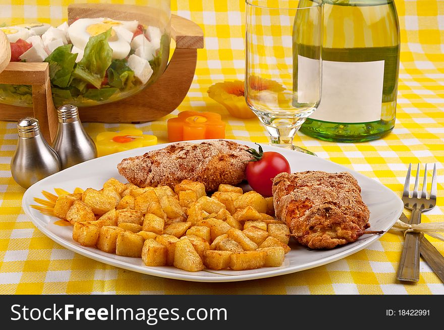 Chicken breast with fried potatoes and salad