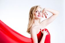 Free Red, Beautiful Blonde In A Red Dress Royalty Free Stock Image - 18430006