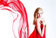 Free Red, Beautiful Blonde In A Red Dress Royalty Free Stock Photography - 18430017
