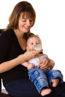 Free Young Mother Feeding Baby Stock Photos - 18430103