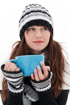 Free Girl Is Dreaming And Holding A Blue Cup Royalty Free Stock Image - 18430616