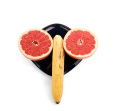 Free Ripe Red Grapefruit (slice The Fruit) And Banana Stock Photos - 18431303
