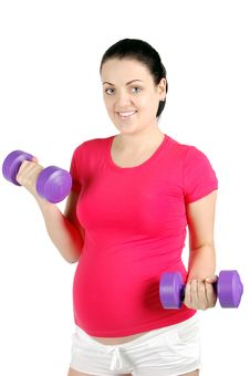 Young Pregnant Woman Making Exercise Royalty Free Stock Photography