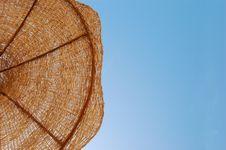 Straw Sun Umbrella Against Sunny Sky Royalty Free Stock Photo